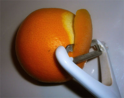 Peeling zest from the orange
